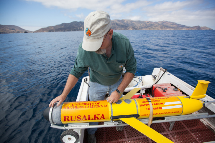 Carl Oberg, an engineering technician for the USC Robotics Research Lab, prepares the submersible robot Rusalka for an underwater mission to monitor levels of acid and other climactic factors  in the Pacific Ocean.