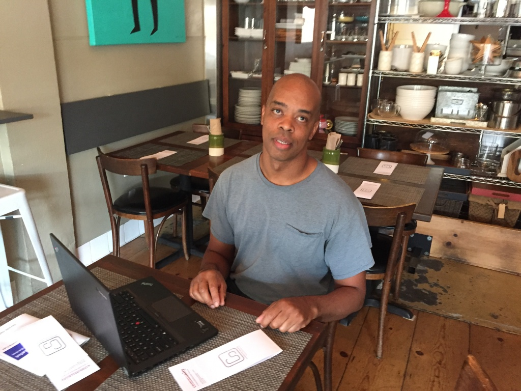 Al Gordon at his restaurant, Community, checks his registration status online and updates his address. Like many renters, Al had moved since the last time he voted and he wasn't receiving election materials.