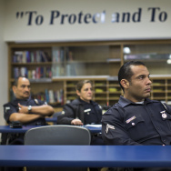 Police officers take part in a check-in from LAPD's Mental Evaluation Unit during a roll call on Friday morning, Jan. 16, 2015 at the Topanga Police Department in Canoga Park.