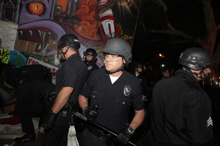 Police officers entered the plaza in riot gear and carrying billy clubs.