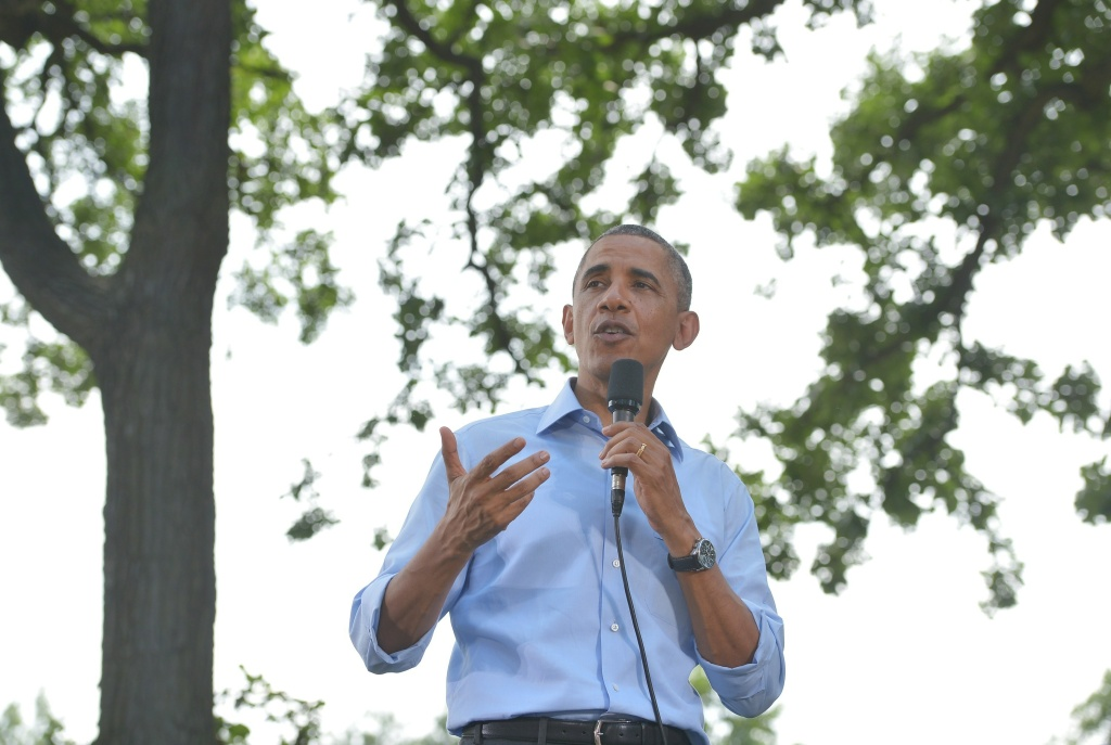 President Barack Obama speaks during a town hall meeting in Minnehaha Park in Minneapolis, Minnesota on June 26, 2014.