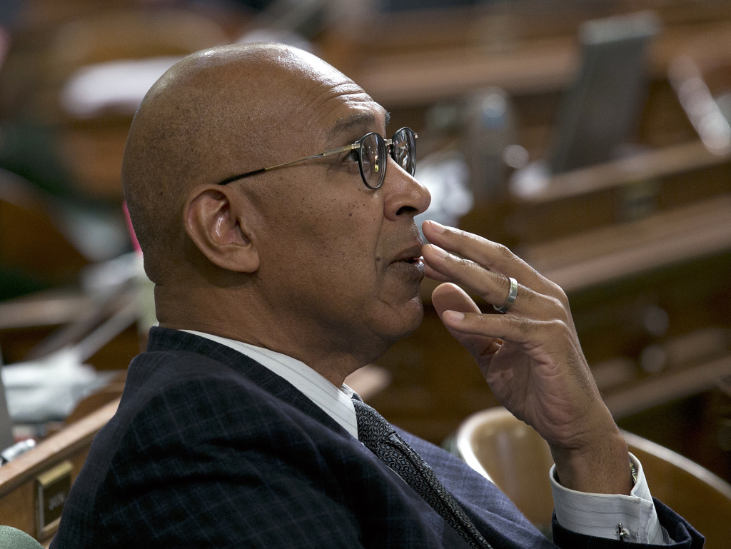 Assemblyman Chris Holden, D-Pasadena, watches as the votes are posted for a measure at the Assembly, Wednesday, Sept. 13, 2017, in Sacramento, Calif. Saying they needed more discussion, Holden withdrew two bills he was sponsoring that would have paved the for merging California's energy ride with others in the West. He hopes to revisit the proposal next year.