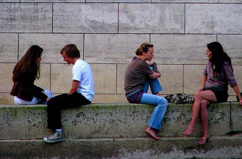 People talk in Paris, France.