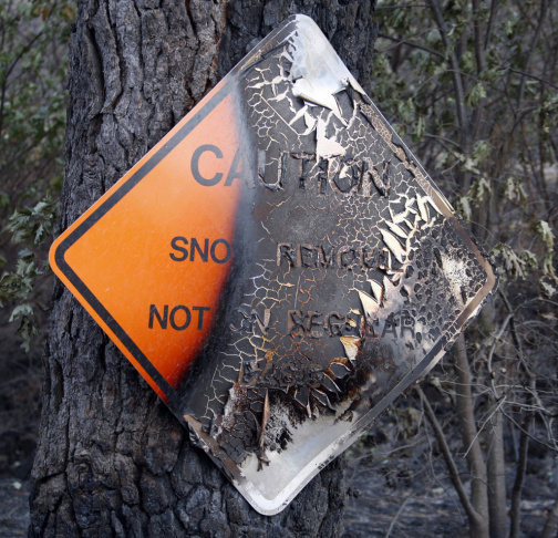 A charred caution sign just outside of California's Yosemite National Park.