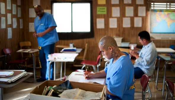 State prison inmates Earl Stewart, left, Ricardo Castillo and Jesus Ledesma take part in a painting class on Tuesday, Nov. 19 at Norco's California Rehabilitation Center.