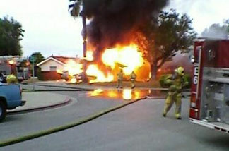 Photo of the Tustin fire that destroyed 2 vehicles and damaged a garage.