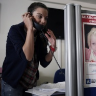 A woman takes a call at Greek charity The Smile of the Child, which is caring for a girl who police say was abducted by a Roma couple. Officials are trying to find her biological parents.
