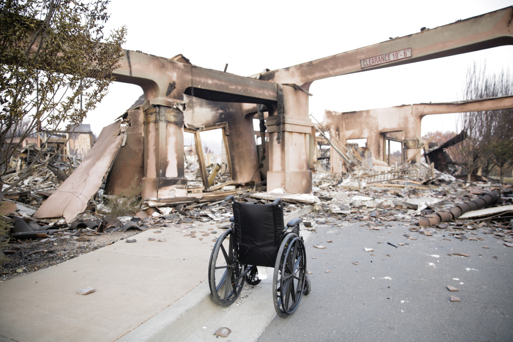 An empty wheelchair is seen in the remains of the Verenna housing development in the Fountaingrove neighborhood of Santa Rosa, California on October 13, 2017.