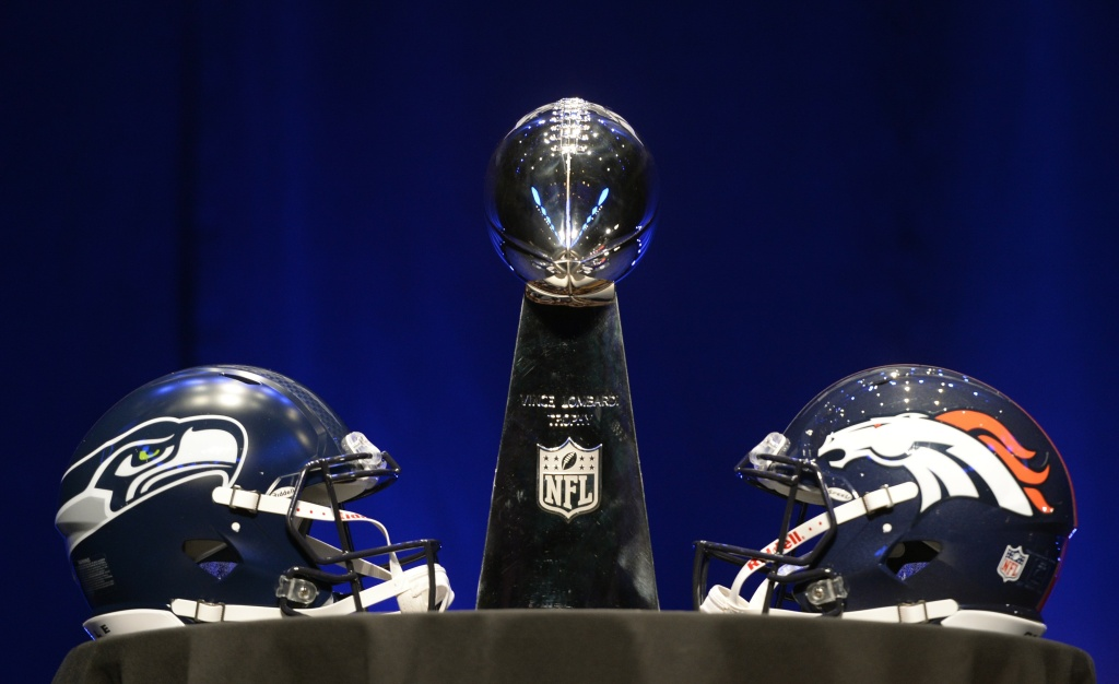 The Vince Lombardi Trophy and helmets for the Denver Broncos(R) and the Seattle Seahawks are displayed prior to a Super Bowl XLVIII head coach joint press conference at the Rose Theater in Jazz at Lincoln Center on January 31, 2014 in New York.