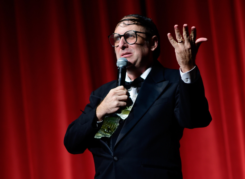 Comedian Neil Hamburger performs onstage following the