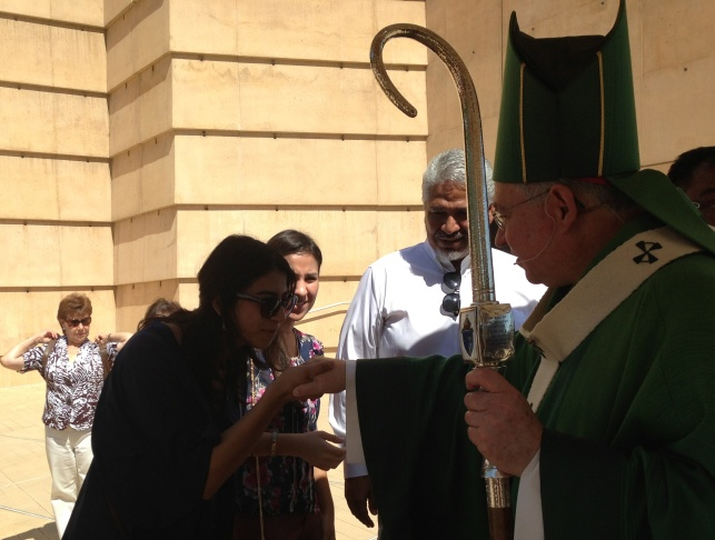 L.A. Archbishop Jose Gomez greets parishioners after a mass devoted to immigration reform September 8.