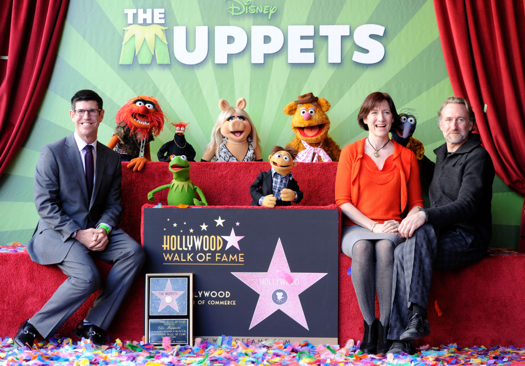 Walt Disney Studios President Rich Ross, (L) attends the Hollywood Walk of Fame star unveiling for The Muppets on March 20, 2012. Ross will be stepping down as Chairman, it was recently announced.