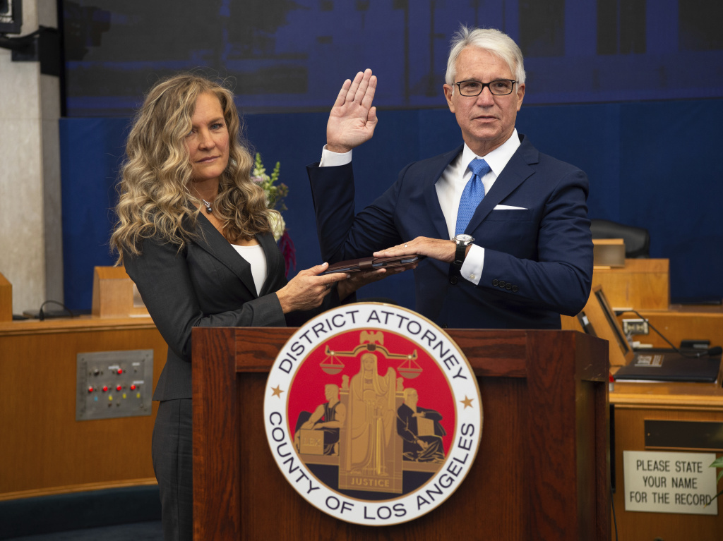 Los Angeles County District Attorney George Gascón is sworn in accompanied, by his wife Fabiola Kramsky. During his inaugural speech, he unveiled a series of criminal justice reforms that impact how prosecutors in his office pursue convictions, sentencing and cash bail.
