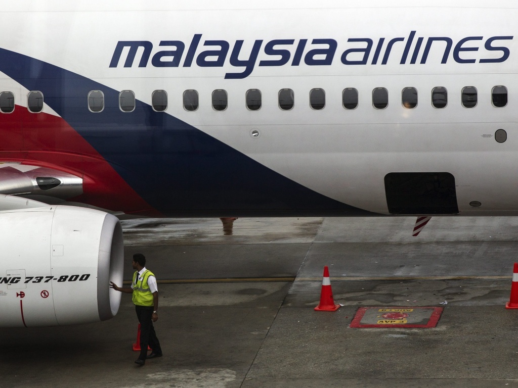 Malaysia Airlines cuts a third of its workforce after steep losses