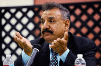 The City of Bell mayor Oscar Hernandez reacts to calls by residents of the city asking for his resignation during a council meeting on July 26, 2010 in Bell, California. The council members have voted to cut their salaries in response to public outcry at city officials' high salaries.