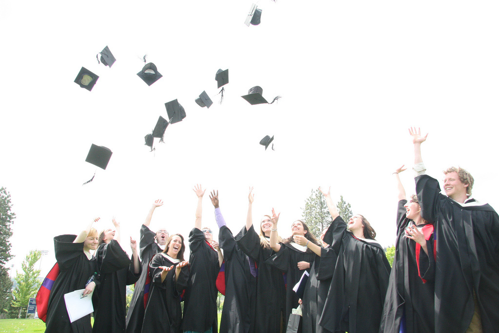 Journalism graduates throw their caps skyward following TRU's Convocation ceremony for the School of Trades and Technology