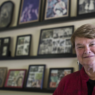Supervisor-elect Sheila Kuehl stands in her home office, where she hangs family photographs and  TV Guide covers from her acting career.
