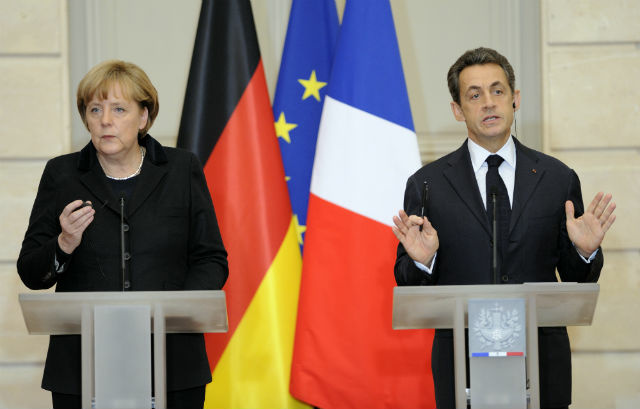 German Chancellor Angela Merkel (L) and French President Nicolas Sarkozy (R) give a press conference after a working lunch at the Elysee palace on December 05, 2011 in Paris. France and Germany want summits of leaders of eurozone states to be held 'every month, as long as the crisis lasts,' Sarkozy said.