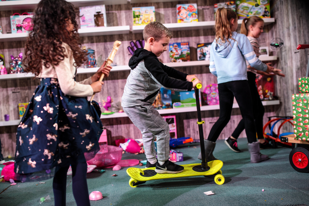 A child rides a 'Morfboard Scoot & Skate' at a 'Dream Toys' event to unveil the top twelve toys this Christmas on November 14, 2018 in London, England.