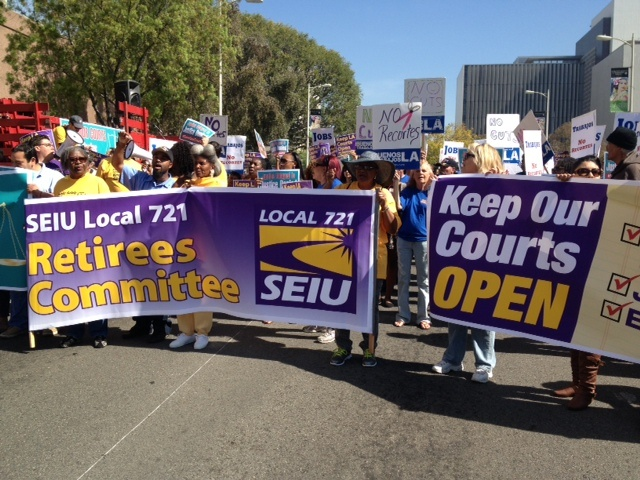 A rally organized by the labor group SEIU Local 721 rallied in downtown Los Angeles in March against the planned L.A. Superior Court layoffs expected in June.