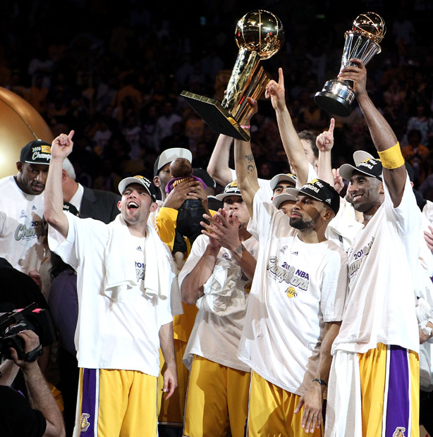 Derek Fisher #2 and Kobe Bryant #24 of the Los Angeles Lakers hold up the Larry O'Brien trophy and the Bill Russell Finals MVP trophy after the Lakers defeated the Boston Celtics in Game Seven of the 2010 NBA Finals at Staples Center on June 17, 2010 in Los Angeles, California.