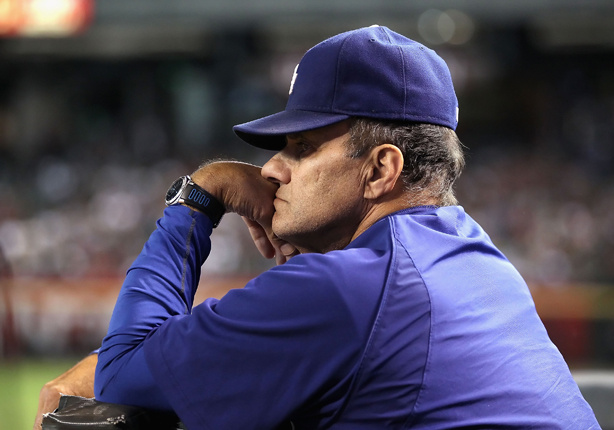 Manager Joe Torre of the Los Angeles Dodgers watches from the dugout during the Major League Baseball game against the Arizona Diamondbacks at Chase Field on September 24, 2010 in Phoenix, Arizona.