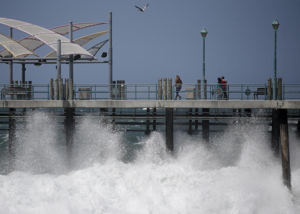 Waves hit the Redondo Beach Pier in Redondo Beach, Calif., Monday, April 8, 2013.