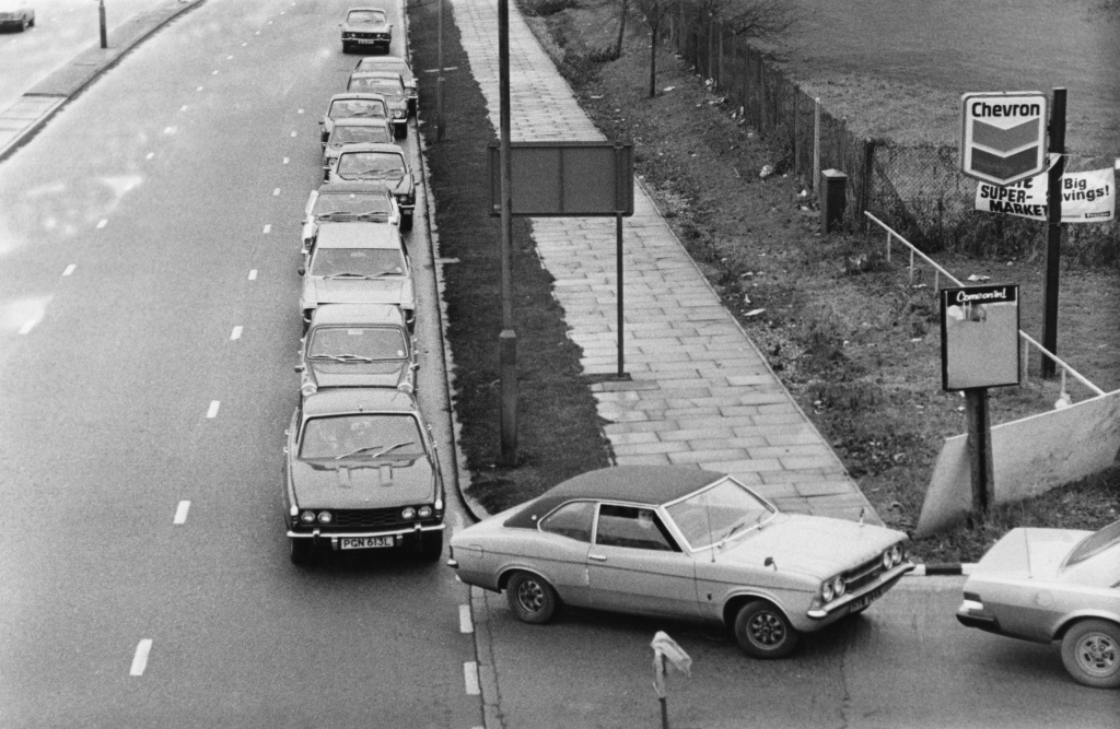 5th December 1973: Cars queuing for fuel during the petrol crisis of 1973.