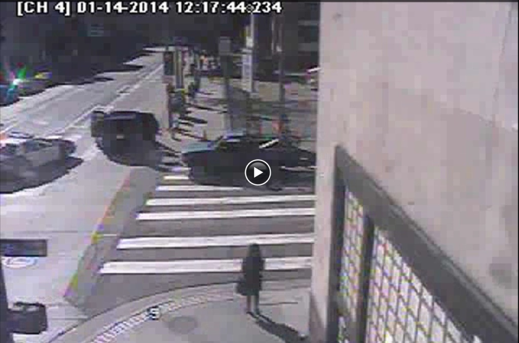 A screencap of surveillance video posted on the Los Angeles Times showing L.A. Mayor Eric Garcetti's SUV striking a pedestrian at Second and Spring streets in Los Angeles on Tuesday, Jan. 14, 2014.
