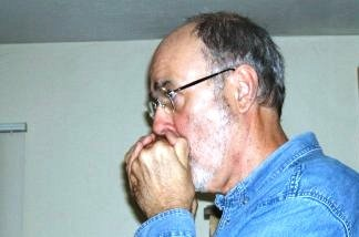 James Sallis, harmonicat and author.