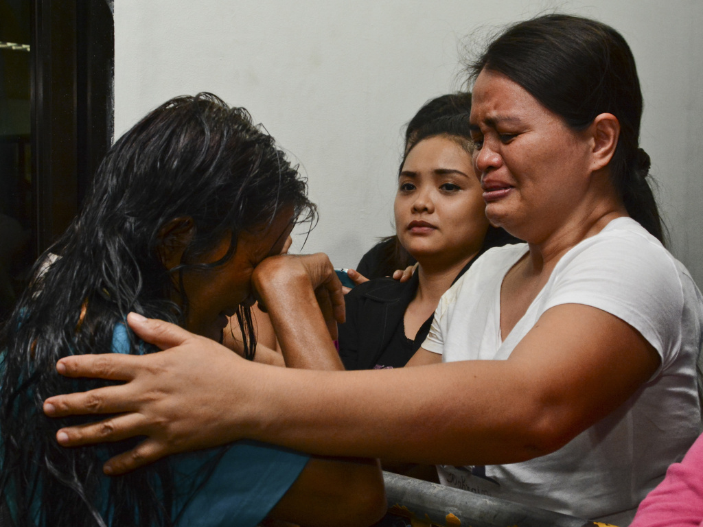 A survivor cries as she arrives at hospital in Cebu after a ferry collided with a cargo ship in Cebu, central Philippines on Friday.
