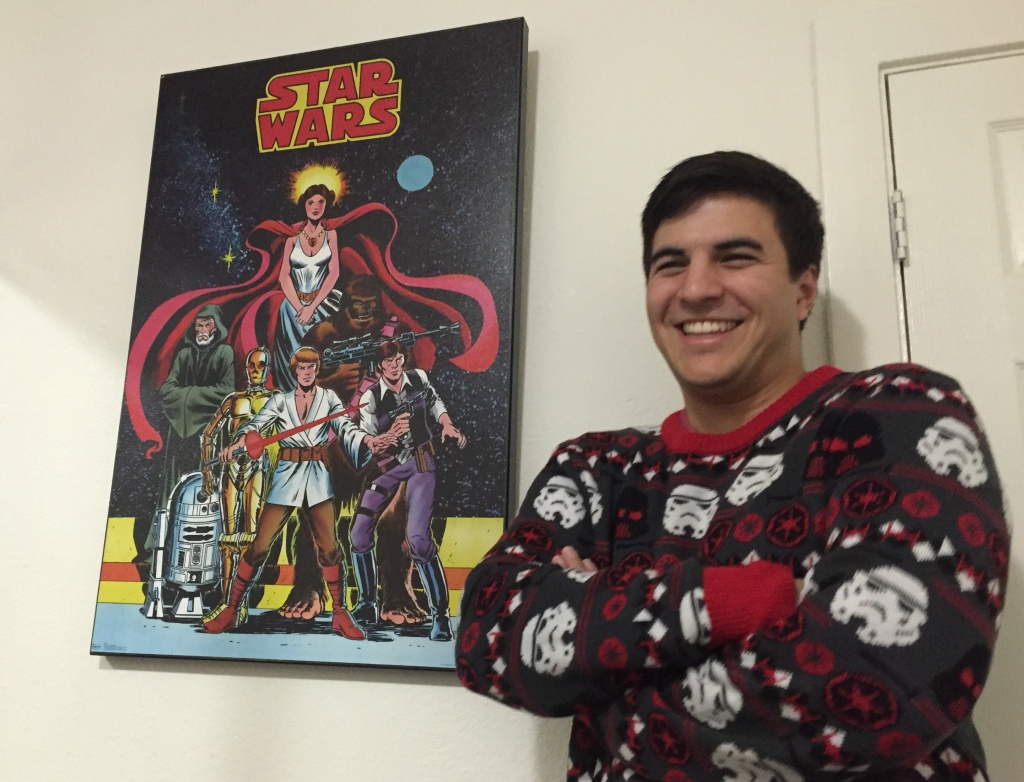 Star Wars superfan Robert Colter stands with a poster from series' original trilogy