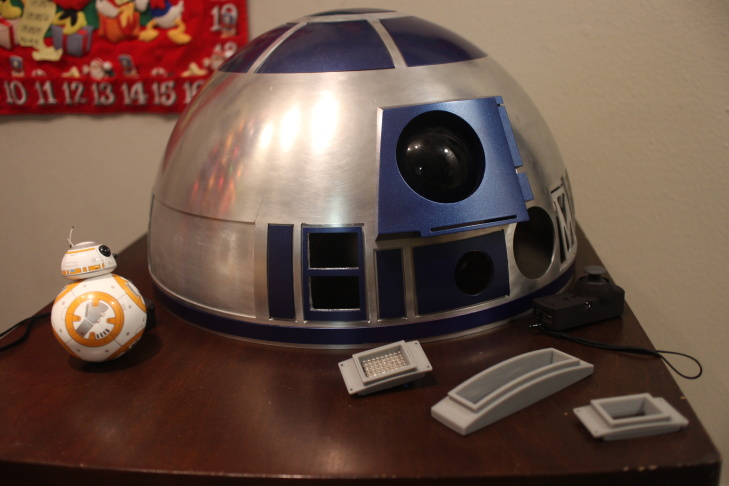 R2 builder Mike Senna poses with his creations in his home in Yorba Linda, Calif.