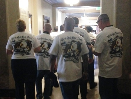 Hundreds of off-duty police officers packed into City Hall Tuesday to call for a new contract.