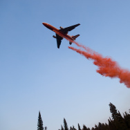 An Airtanker dropping fire retardant on a wildfire at The Springs FIre in Banks-Garden Valley, ID, Boise National Forest, Idaho Dept. of Lands, August, 2012. This photo was taken with a drone