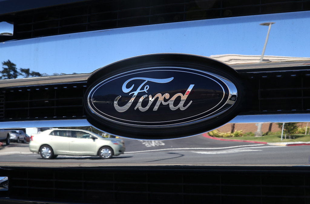 COLMA, CA - MAY 01:  The Ford logo is displayed on the grill of a brand new truck on the sales lot at Serramonte Ford in Colma, California.