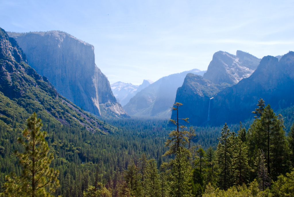 A view of Yosemite Valley, with El Capitan to the left and Half Dome in the background.