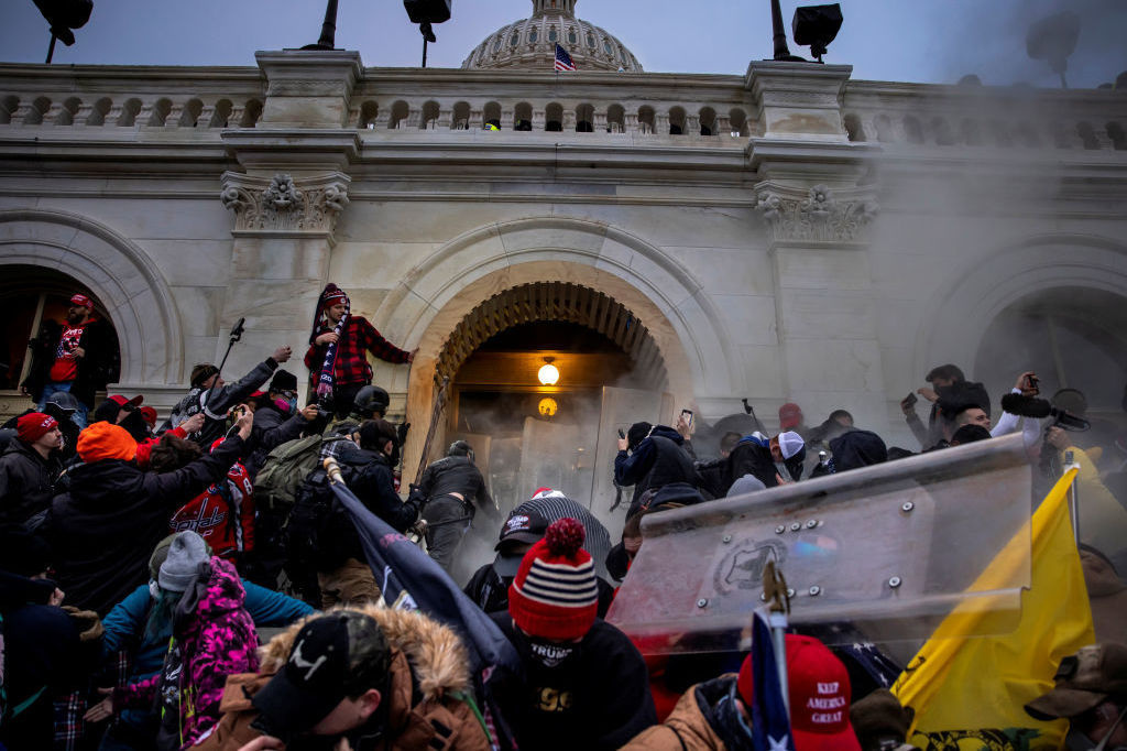 Pro-Trump rioters clash with police and security forces as people storm the U.S. Capitol on Jan. 6. Federal investigators say they expect even more people will be charged in connection with the insurrection.