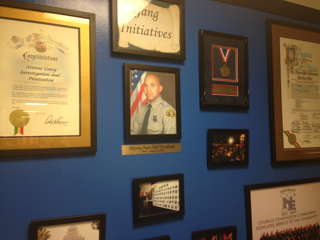 A wall in LAPD's Northeast Community Station houses the division's awards for gang initiatives, as well as a memorial to murdered Sheriff's Deputy Juan Abel Escalante.