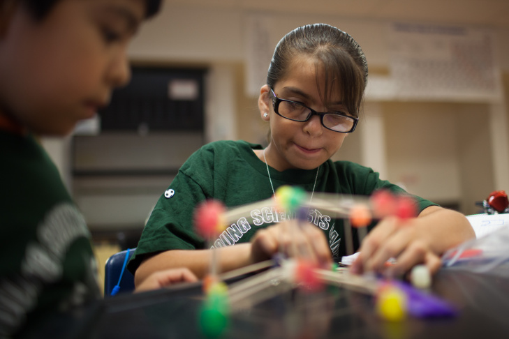 Emma builds a bridge out of gum drops and toothpicks during science camp at Cabrillo High School in Long Beach, Calif., on July 23.