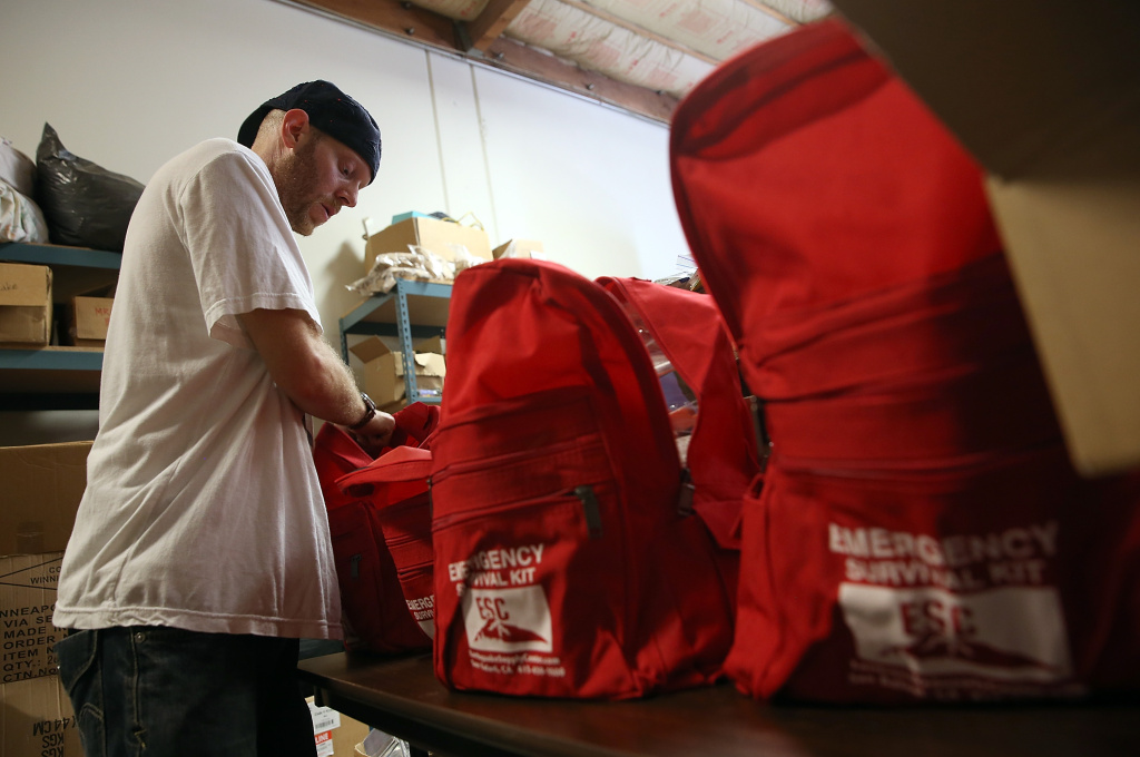 Marc Rich assembles emergency survival kits at Earthquake Supply Center on August 27, 2014 in San Rafael, California.