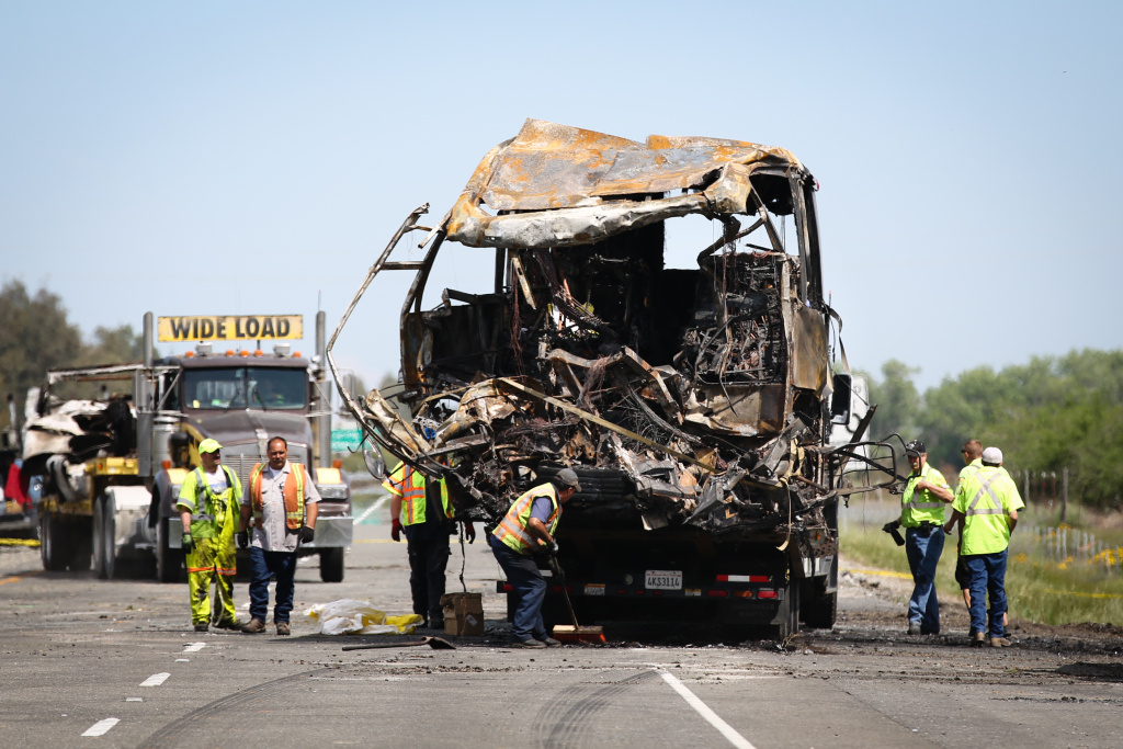 A bus involved in Thursday's deadly crash is loaded on to a truck at the scene on April 11, 2014  in Orland, California. Ten people were killed and dozens injured after a FedEx truck collided with a bus of high school students on Interstate 5. The students were on their way to visit Humboldt State University in Northern California.