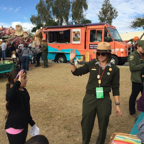 Ranger Kya-Marina Le hands out wildflower seed packets at LA Ranger Troca's official debut at Olvera Street on Feb. 24, 2016.