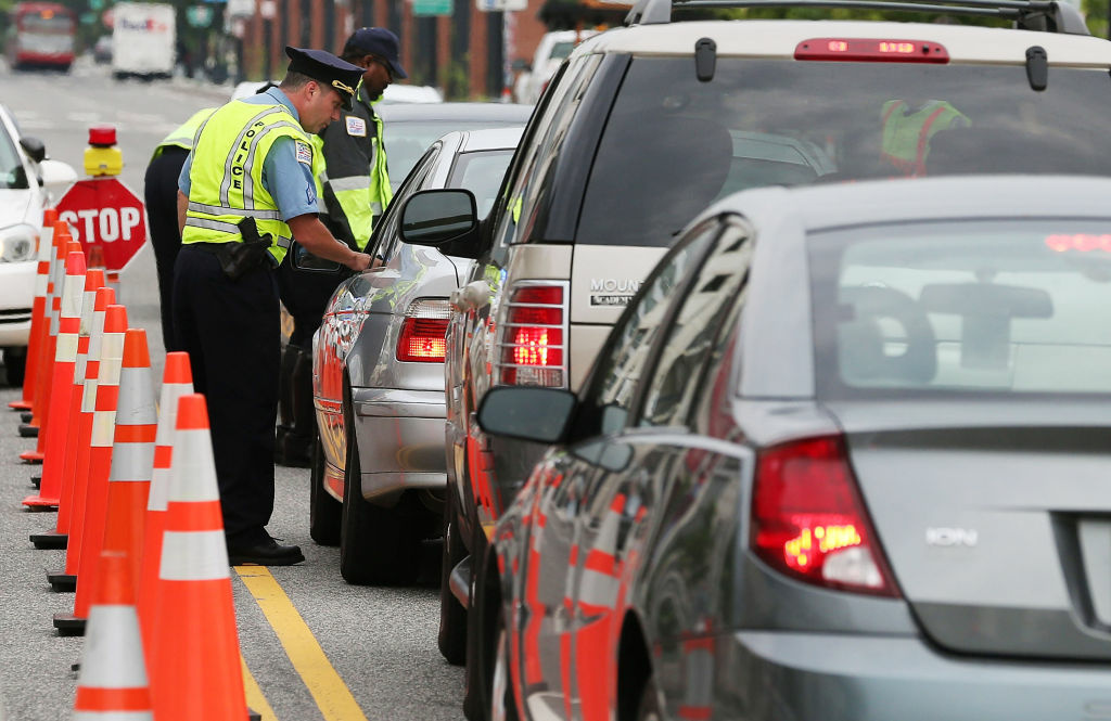 Washington Metropolitan Police conduct a sobriety check point associated with a news conference on drunk driving, on August 14, 2012 in Washington, DC.