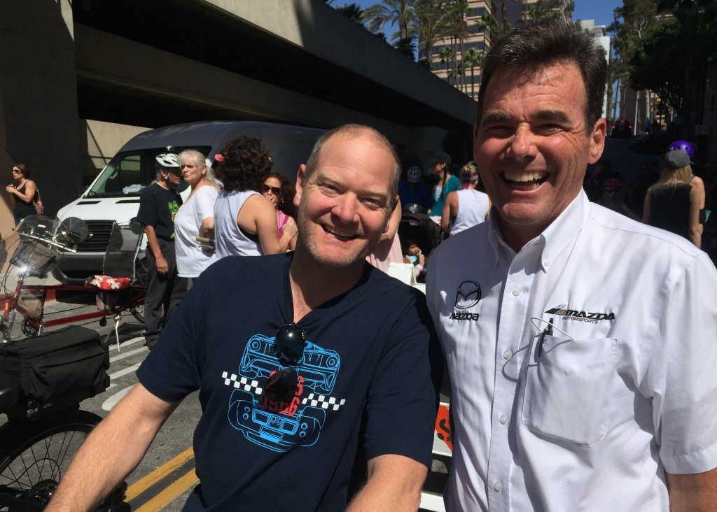 Race car driver Tommy Kendall and Mazda Motorsports communications officer Dean Case.