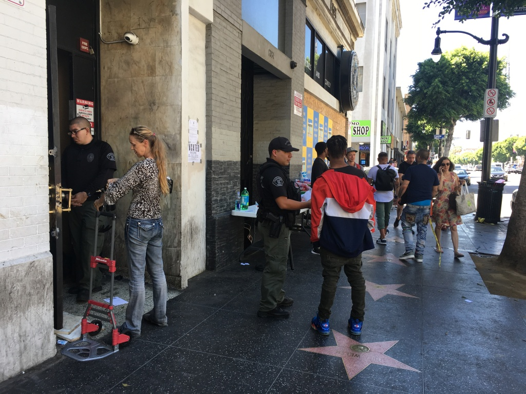 Former occupants of an illegally converted commercial building had to confer with security guards to retrieve their belongings after a police raid to vacate the building at 6362 Hollywood Blvd.