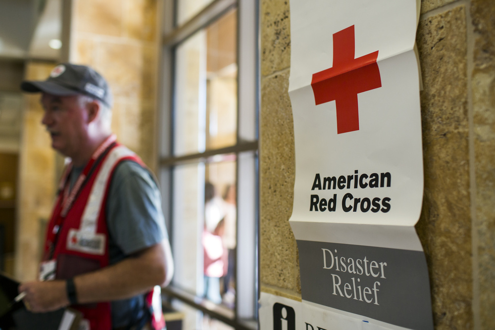 John Monahan of Orange County, a Red Cross volunteer, works the registration desk at a Red Cross evacuation center at Fontana Park Community Center on Wednesday morning, Aug. 17, 2016. As of the morning, 98 people have checked into the center.