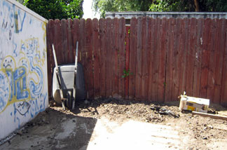 This photo shows some of the backyard of a house in Ontario, Calif. Tuesday, May 31, 2011. Police arrested 51-year-old Carmen Montenegro Sunday night in an Ontario neighborhood where Investigators spent Monday excavating this property outside the home where the body is believed to have been buried.