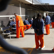 "Inmates in a recreation yard at the Deuel Vocational Institution in Tracy, Calif. California is trying to address court-ordered reductions in overcrowding with a plan to shift thousands of those convicted of ""non-serious"" crimes to county jails."