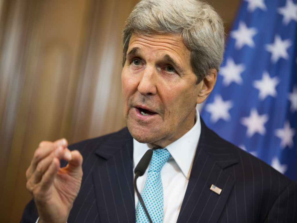 Secretary of State John Kerry gestures during a news conference with German Foreign Minister Frank-Walter Steinmeier about the ongoing crisis in Syria, at Villa Borsig, Berlin, on Sunday.